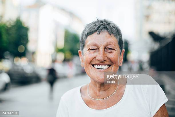 Cheerful senior woman in the summer
