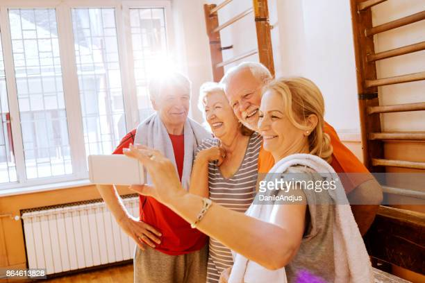 cheerful seniors taking a group selfie