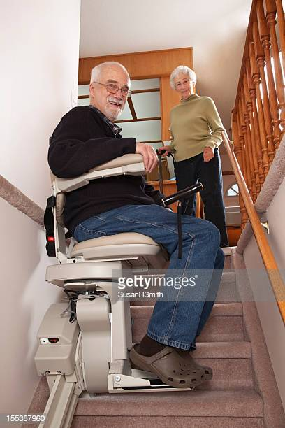 cheerful seniors with stairlift: assisted living - trap buiten stockfoto's en -beelden