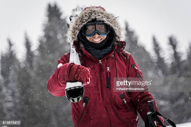 cheerful skier posing - parka coat stock photos and pictures
