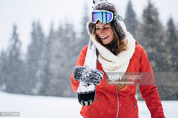 cheerful skier walking through snowy forest - jacket stock pictures, royalty-free photos & images