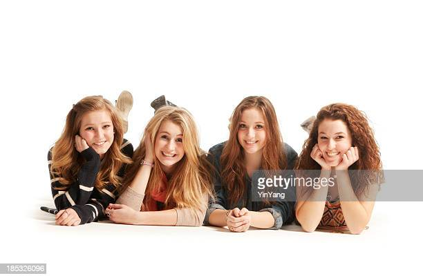 Cheerful Smiling Cute Young Teen Girls Laying on Floor