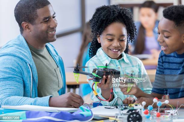 cheerful stem middle school students build drone - science photo library stock pictures, royalty-free photos & images