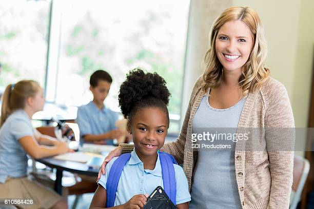 cheerful stem school teacher with her student - charter_school stock pictures, royalty-free photos & images