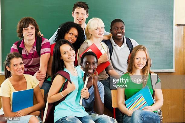 Cheerful students looking at the camera.