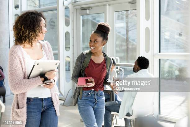 cheerful students walking together to class - community college stock pictures, royalty-free photos & images