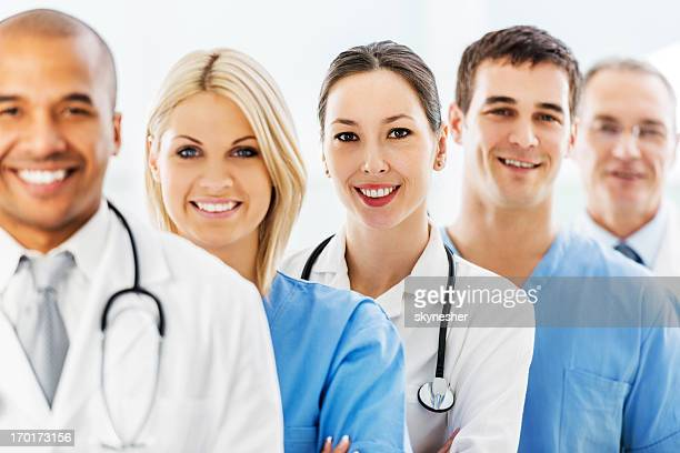 Cheerful successful team of doctors.