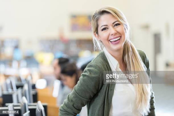 Cheerful teacher in computer lab