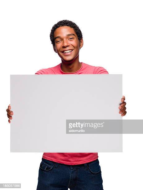 Cheerful Teenager holding a sign