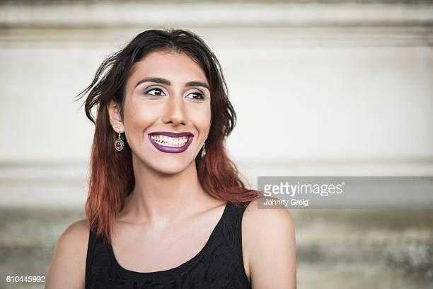 Cheerful transgender female laughing, looking away