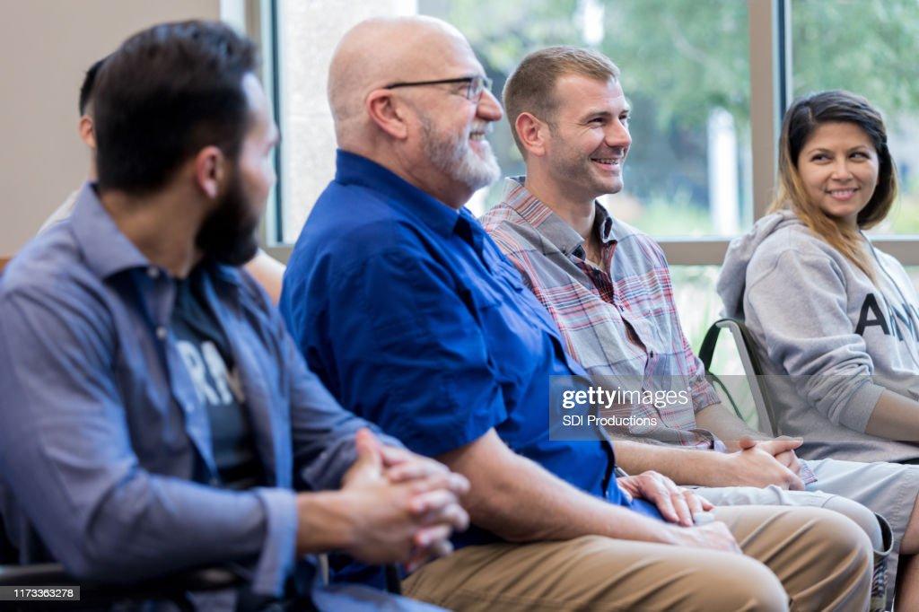 Cheerful veterans attending seminar : Stock Photo