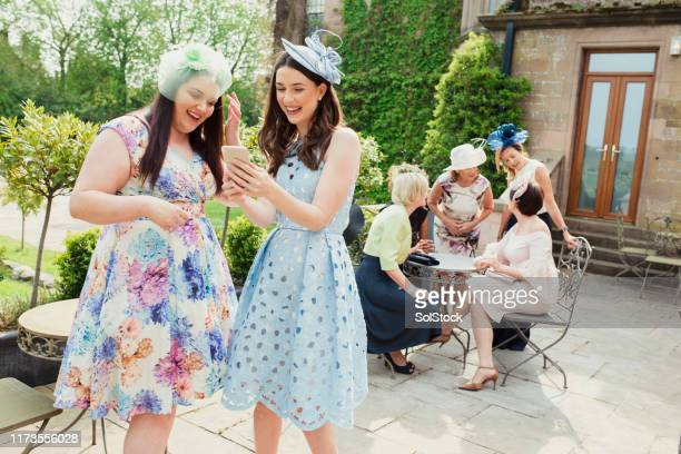 cheerful wedding guests - fascinator stock pictures, royalty-free photos & images