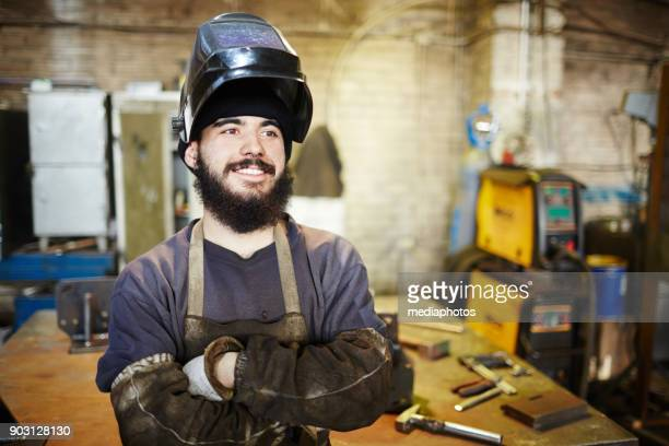 Cheerful welder dreaming of own production