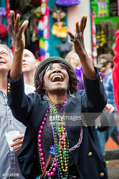 cheerful woman at mardi gras 2013 in new orleans - mardi gras fun in new orleans stock photos and pictures
