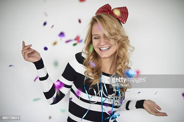 cheerful woman celebrating great party. debica, poland - streamer stock photos and pictures