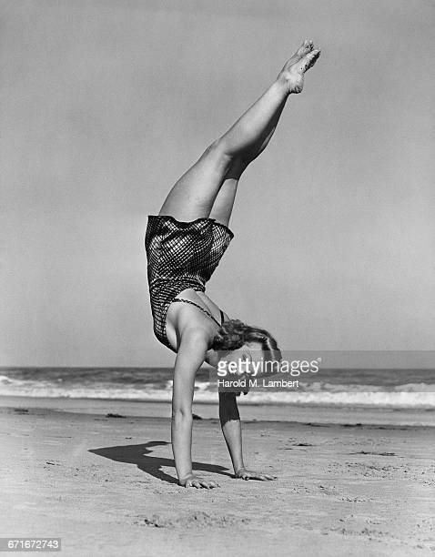 Cheerful Woman Doing Handstand