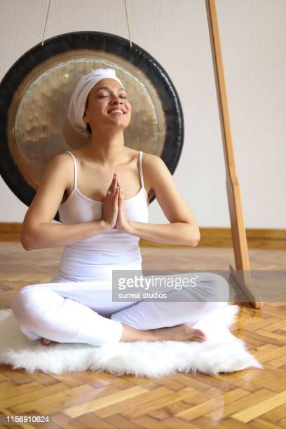 cheerful woman doing kundalini yoga - gong stock pictures, royalty-free photos & images