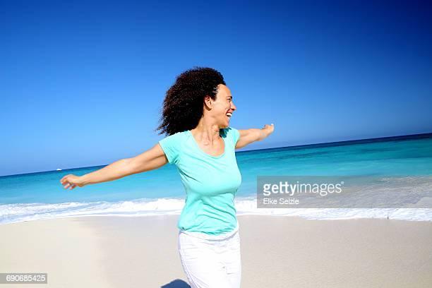 Cheerful Woman Enjoying Pristine Beach