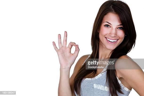 Cheerful woman gesturing OK