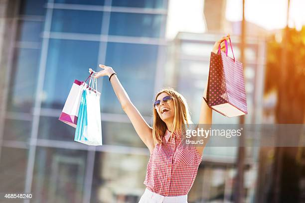 Cheerful woman having fun in shopping.