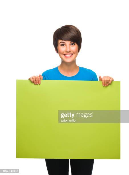 Cheerful woman holding a sign