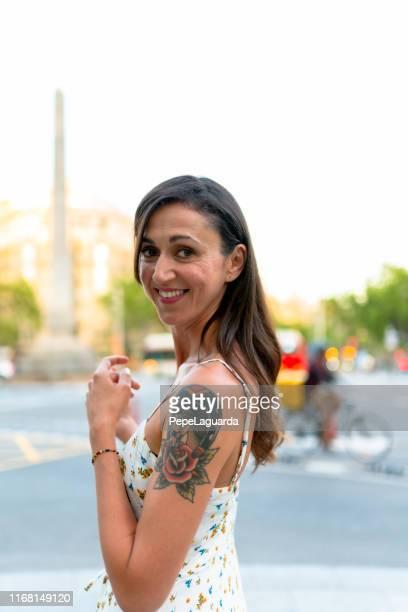 Cheerful woman in Passeig de Gràcia, Barcelona