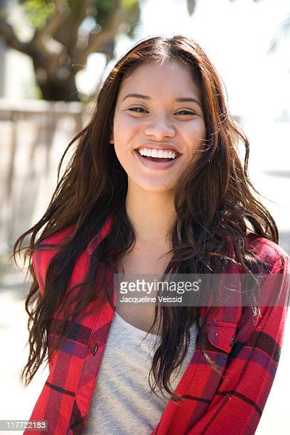 cheerful woman in red flannel shirt - beautiful filipino women stock photos and pictures
