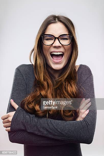 cheerful woman laughing against white background - mouth open stock pictures, royalty-free photos & images