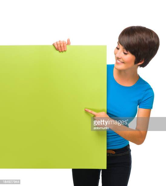 Cheerful woman looking at a sign