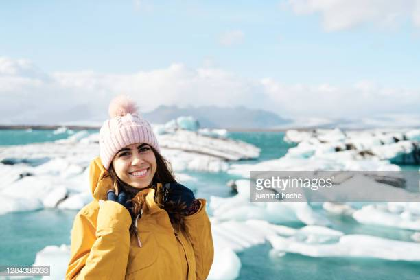 cheerful woman near sea on winter day - iceland stock pictures, royalty-free photos & images