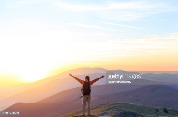cheerful woman on top mountain - sunrise mountain peak stock pictures, royalty-free photos & images