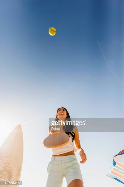 cheerful woman playing table tennis against sky - table tennis racket stock pictures, royalty-free photos & images