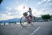 young woman riding bicycle lake city