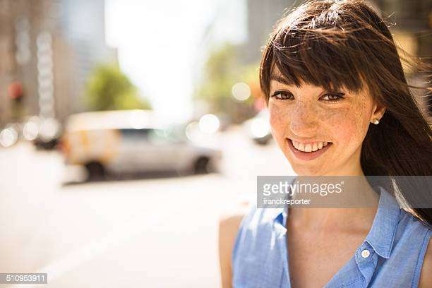 cheerful woman smiling on the city