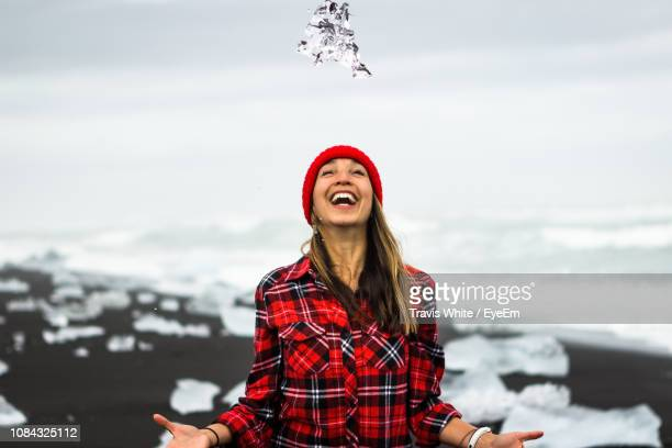 cheerful woman standing at beach during winter - punalu'u_beach stock pictures, royalty-free photos & images