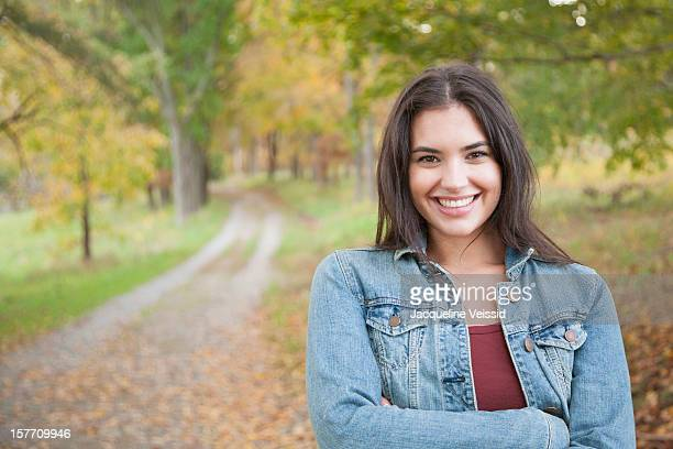 Cheerful woman standing on path in nature