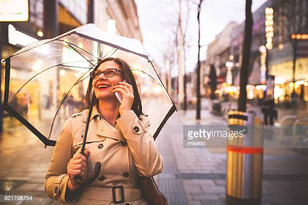 Cheerful woman talking on smartphone