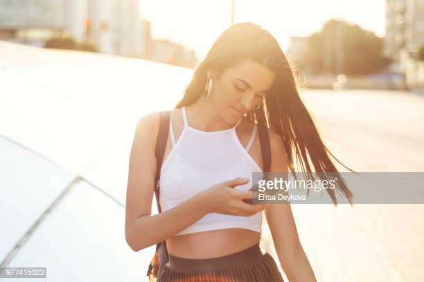 Cheerful woman using phone