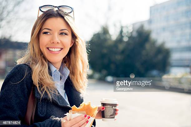 Cheerful woman using smart phone