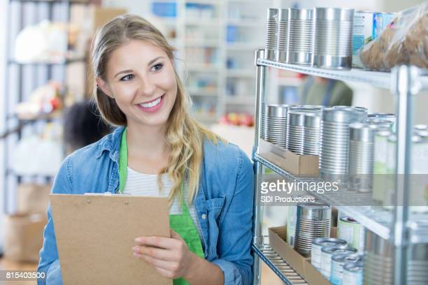 Cheerful woman volunteers in food bank
