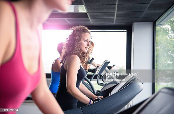 cheerful woman walking on the gym treadmill - circuit training stock photos and pictures