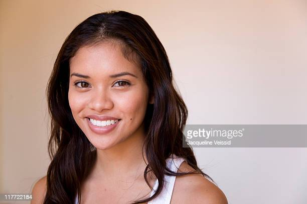 cheerful woman with long hair smiling - filipino - fotografias e filmes do acervo