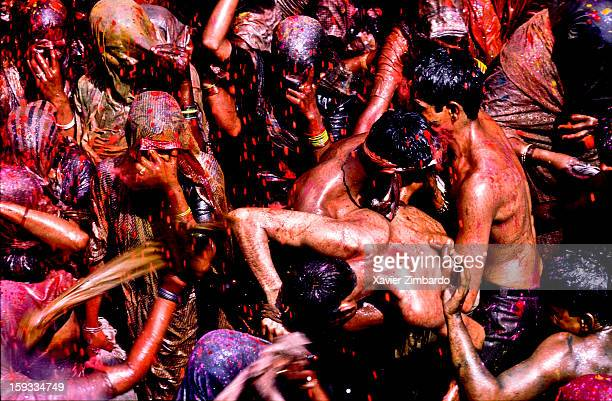 Cheerful women beating men among crowds of pilgrims playing Huranga Holi on March 9 at Dauji Ka Mandir Baldev India