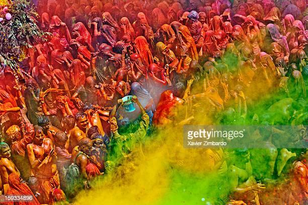 Cheerful women beating men among crowds of pilgrims playing Huranga Holi on March 12 at Dauji Ka Mandir Baldev India