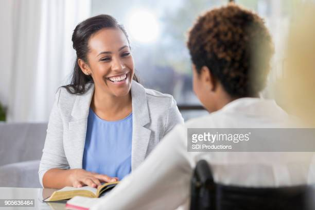Cheerful women participate in Bible study