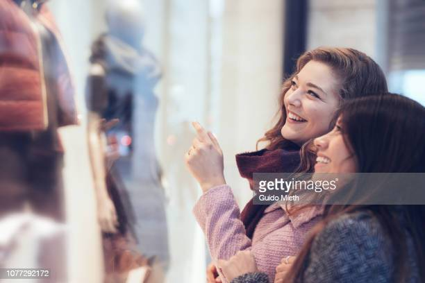 cheerful women shopping in berlin. - winter coat stock pictures, royalty-free photos & images