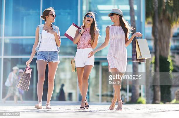 Cheerful women shopping in the city and having fun.