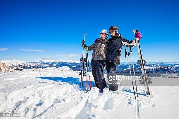 cheerful women skiers on top of ski resort - carinthia stock pictures, royalty-free photos & images