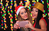cheerful women taking selfie at new