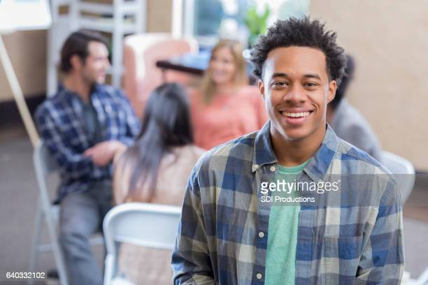 Cheerful young African American man smiles before therapy session